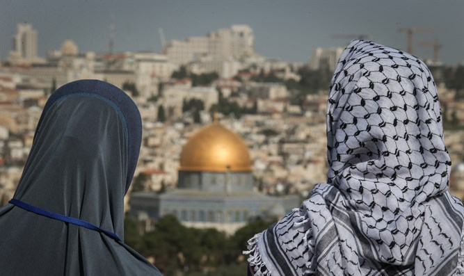 Arabs view Dome of the Rock on Jerusalem's Temple Mount